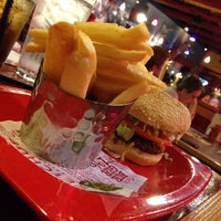 Photo taken at Red Robin Gourmet Burgers by Ashley J. on 10/7/2014