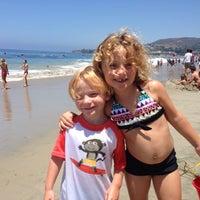 Photo taken at Anita Street Beach by Todd M. on 7/4/2014