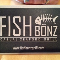Photo taken at FishBonz Grill by Carlos T. on 10/24/2013