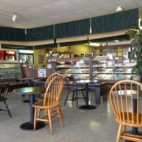 Photo taken at Munchers Bakery by Lori T. on 5/11/2013