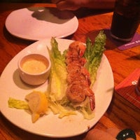 Photo taken at Outback Steakhouse by Ivy S. on 9/14/2012