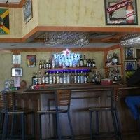 Photo taken at Jamaica Gates Caribbean Restaurant by Tametra P. on 5/4/2013