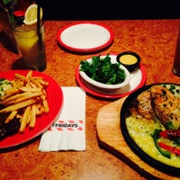 Photo taken at T.G.I. Friday's by Erin R. on 1/29/2015