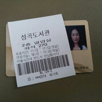 Photo taken at 국민대학교 성곡도서관 by Gahee C. on 7/15/2013