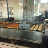 Photo taken at Krispy Kreme Doughnuts by Alejandrina D. on 12/31/2012