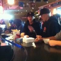 Photo taken at Applebee's Neighborhood Grill & Bar by Erika P. on 12/15/2013