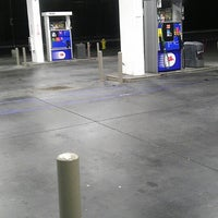 Photo taken at Mobil by J.R. on 6/8/2014