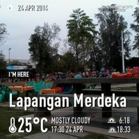 Photo taken at Lapangan Merdeka by Zha C. on 4/24/2014