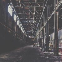 Photo taken at Domino Sugar Factory by Champ E. on 7/24/2013
