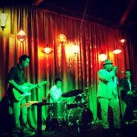 Photo taken at Hip Kitty Jazz & Fondue by Shane B. on 7/21/2013