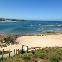 Photo taken at Praia de Vila Nova de Milfontes by Alisa on 5/12/2014