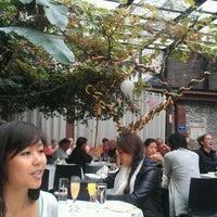 Photo taken at Revel Restaurant and Garden by Jocelyn on 10/7/2012