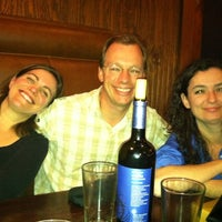 Photo taken at New Socials Bar & Grille by Deitra S. on 12/8/2012