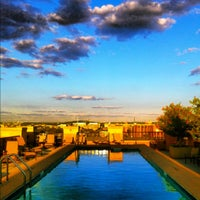 Photo taken at The Whitman Rooftop Pool by Erica E. on 9/15/2012