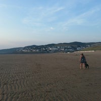 Photo taken at Woolacombe Beach by Glenn L. on 7/18/2013