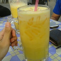 Photo taken at Uptown Parit Raja by Zaimie J. on 5/24/2015