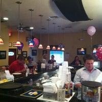 Photo taken at Eats American Grill by Jillian K. on 2/27/2013