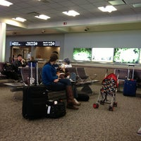 Photo taken at Gate A5 by Eva G. on 12/31/2012