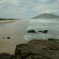Photo taken at Costão da Praia do Santinho by Kiti S. on 10/17/2012