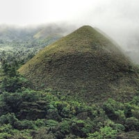 Photo taken at The Chocolate Hills by Dodjie M. on 1/30/2013