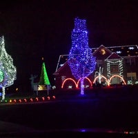 Photo taken at Our Dancing Lights by Christine G. on 12/1/2013