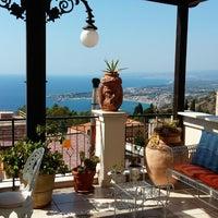 Photo taken at Taodomus Hotel Taormina by Cristhian S. on 8/6/2015