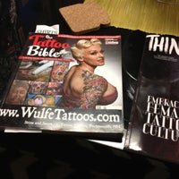 Photo taken at Grim North Tattoo & Piercing by Chris D. on 12/15/2012