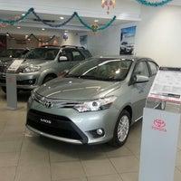 Photo taken at Toyota Showroom by Lilian { Joe & Yern } on 10/28/2013