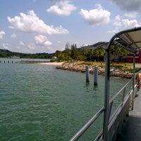 Photo taken at Marina Island Jetty Complex by Najib Z. on 10/10/2012