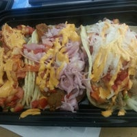 Photo taken at Korilla BBQ by Sammy N. on 10/1/2012