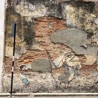 Photo taken at Penang Street Art : Little Boy with Pet Dinosaur by Sharon M. on 3/26/2016
