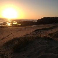 Photo taken at Praia de Vila Nova de Milfontes by JCarlosNg on 5/24/2013