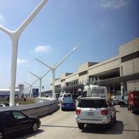Photo taken at Tom Bradley International Terminal (TBIT) by Zhiyong F. on 8/6/2013