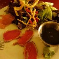 Photo taken at Tahoe Joe's Famous Steakhouse by Cynthia F. on 5/4/2016