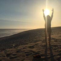 Photo taken at Sardinia Bay Beach by Asli Ece K. on 3/17/2017