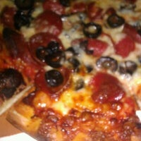 Photo taken at Famous Pizza by Brenda J. on 9/15/2012