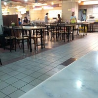 Photo taken at Kompleks Karamunsing Food Court by Michy F. on 11/11/2012
