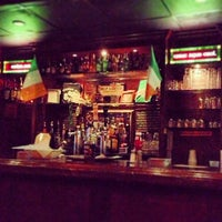 Photo taken at Madra Rua Irish Pub by Idoitforthebacon on 7/5/2013