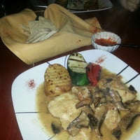 Photo taken at King Tut Middle Eastern & Mediterranean Cuisine by Jay L. on 12/23/2013
