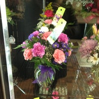Photo taken at Brennan's Florist by Eric C. on 2/2/2013