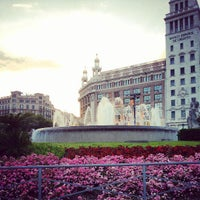 Photo taken at Plaça de Catalunya by Rapha D. on 5/27/2013