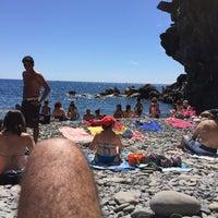 Photo taken at Spiaggia di Riomaggiore by Fabien A. on 6/25/2015