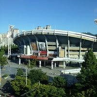 Photo taken at Sajik Baseball Stadium by Kawa T. on 7/17/2013