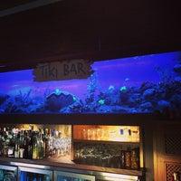 Photo taken at Tiki Restaurant Lounge Bar by Monica R. on 4/2/2015