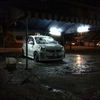 Photo taken at Abang Car Wash & Polish by Ayie A. on 1/1/2013