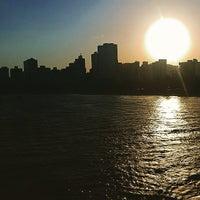 Photo taken at Praia do Canto by Caue L. on 1/13/2015
