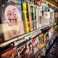 Photo taken at Marck's Brentwood NewsStand by Gorkem U. on 7/14/2014