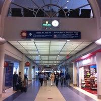 Photo taken at Terminal 4 by Ej T. on 10/20/2012