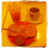 Photo taken at Ya Kun Kaya Toast by Pietro M. on 2/27/2013