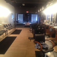 Photo taken at Top of the Line Barbershop by Alexis A. on 2/24/2013